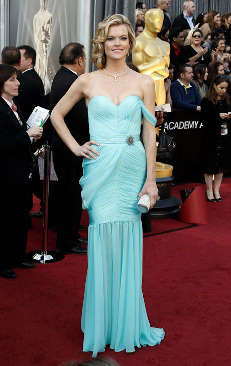 Missi Pyle arrives before the 84th Academy Awards on Sunday, Feb. 26, 2012, in the Hollywood section of Los Angeles. Pyle wore a minty-hued strapeless gown with draping details and a sweetheart neckline. The Valentina Delfino gown is made of eco-friendly materials, even down to the zipper. <span class=meta>(AP Photo&#47; Matt Sayles)</span>