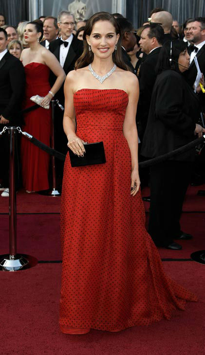 "<div class=""meta ""><span class=""caption-text "">Natalie Portman arrives before the 84th Academy Awards on Sunday, Feb. 26, 2012, in the Hollywood section of Los Angeles. Portman wore a deep red vintage Dior strapless gown. (AP Photo/ Matt Sayles)</span></div>"