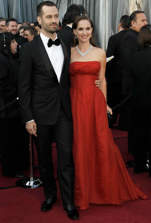 Benjamin Millepied, left, and Natalie Portman arrive before the 84th Academy Awards on Sunday, Feb. 26, 2012, in the Hollywood section of Los Angeles. Portman wore a deep red vintage Dior strapless gown. <span class=meta>(AP Photo&#47; Matt Sayles)</span>