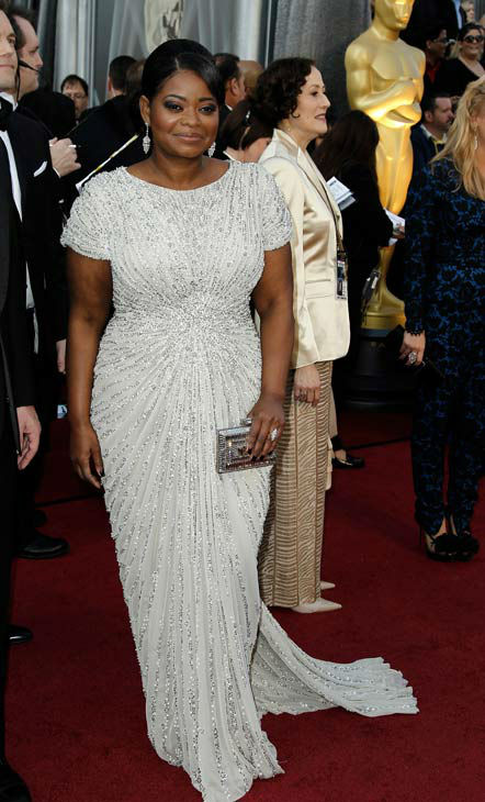 Octavia Spencer arrives before the 84th Academy Awards on Sunday, Feb. 26, 2012, in the Hollywood section of Los Angeles. Spencer looked glamorous in a white, beaded short-sleeved Tadashi Shoji gown and rounded out her look with a silver box clutch and silver drop earrings to match. <span class=meta>(AP Photo&#47; Matt Sayles)</span>