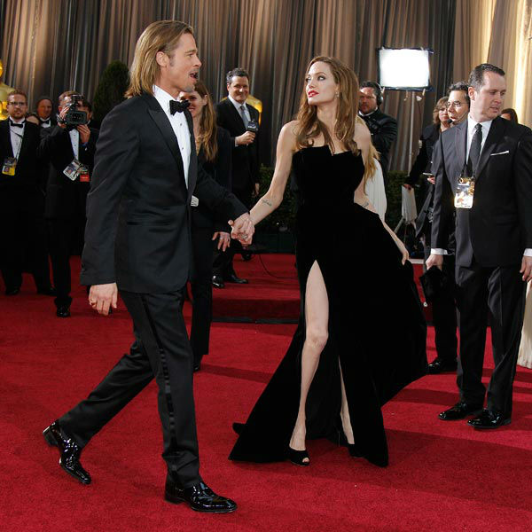 Actress Angelina Jolie, right, and actor Brad Pitt arrive before the 84th Academy Awards on Sunday, Feb. 26, 2012, in the Hollywood section of Los Angeles. Jolie wore a black velvet Atelier Versace gown to the event.  <span class=meta>(AP Photo&#47; Amy Sancetta)</span>