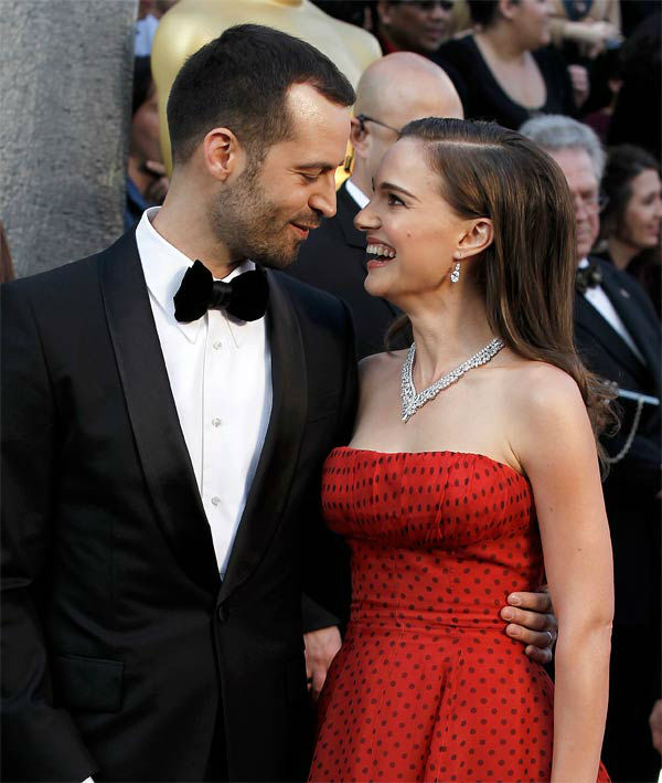 "<div class=""meta ""><span class=""caption-text "">Benjamin Millepied, left, and Natalie Portman arrive before the 84th Academy Awards on Sunday, Feb. 26, 2012, in the Hollywood section of Los Angeles. Portman wore a deep red vintage Dior strapless gown. (AP Photo/ Matt Sayles)</span></div>"
