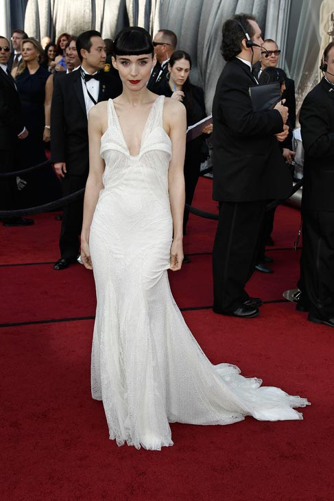 Rooney Mara arrives before the 84th Academy Awards on Sunday, Feb. 26, 2012, in the Hollywood section of Los Angeles. The actress wore a Givenchy Couture gown with delicate white lace throughout and a plunging neckline. The dress had a fragile, ethereal vibe in sharp contrast against her jet black hair, blunt bangs and dramatic red lips.  <span class=meta>(AP Photo&#47; Matt Sayles)</span>