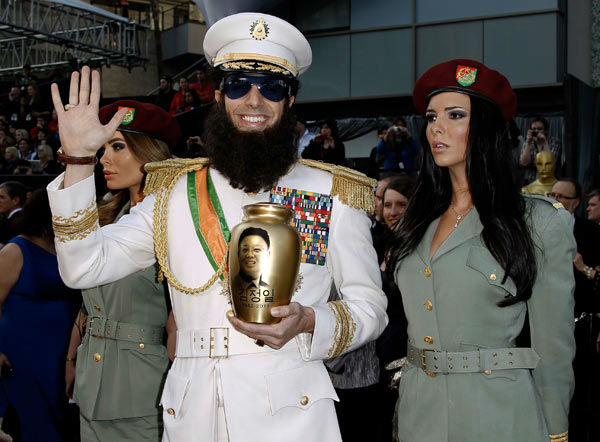 "<div class=""meta ""><span class=""caption-text "">Sacha Baron Cohen, center, and guests arrive before the 84th Academy Awards on Sunday, Feb. 26, 2012, in the Hollywood section of Los Angeles. (AP Photo/ Matt Sayles)</span></div>"