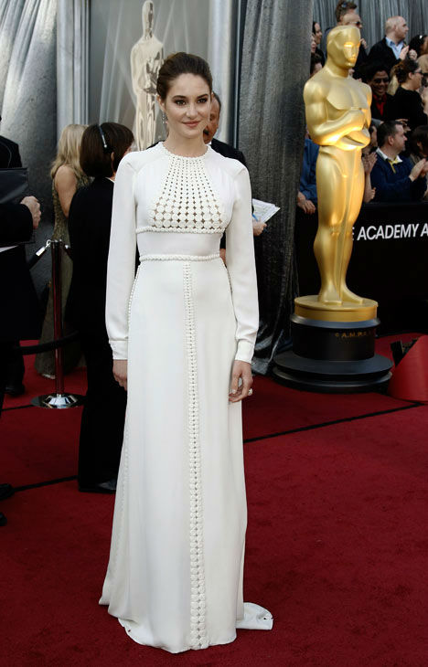 "<div class=""meta ""><span class=""caption-text "">Shailene Woodley arrives before the 84th Academy Awards on Sunday, Feb. 26, 2012, in the Hollywood section of Los Angeles. 'The Descendants' actress was all covered up in a white, long-sleeve, floor-length Valentino gown. The dress featured a crew neck and small cutout details in the front and down the skirt. (AP Photo/ Matt Sayles)</span></div>"