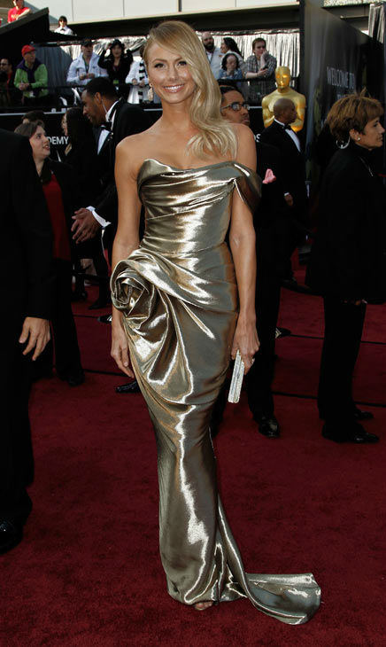 Stacy Keibler arrives before the 84th Academy Awards on Sunday, Feb. 26, 2012, in the Hollywood section of Los Angeles. Keibler, who was accompanying best-actor nominated George Clooney, was decked out in a metallic gold strapless Marchesa gown with a gathered rose detail on the hip. <span class=meta>(AP Photo&#47; Matt Sayles)</span>