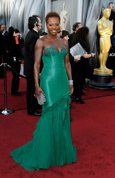 "<div class=""meta ""><span class=""caption-text "">Viola Davis arrives before the 84th Academy Awards on Sunday, Feb. 26, 2012, in the Hollywood section of Los Angeles. Viola Davis wore a custom Vera Wang emerald green corseted faille gown with floral crystal applique and draped chiffon pleated skirt. (AP Photo/ Matt Sayles)</span></div>"