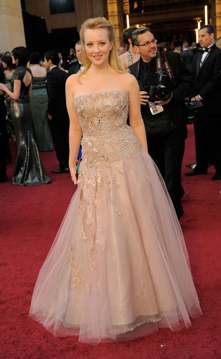 Wendi McLendon-Covey arrives before the 84th Academy Awards on Sunday, Feb. 26, 2012, in the Hollywood section of Los Angeles. The &#39;Bridesmaids&#39; actress wore a blush tulle gown with champagne beading paired with Simon G jewels and Christian Louboutin shoes and clutch. <span class=meta>(AP Photo&#47; Chris Pizzello)</span>