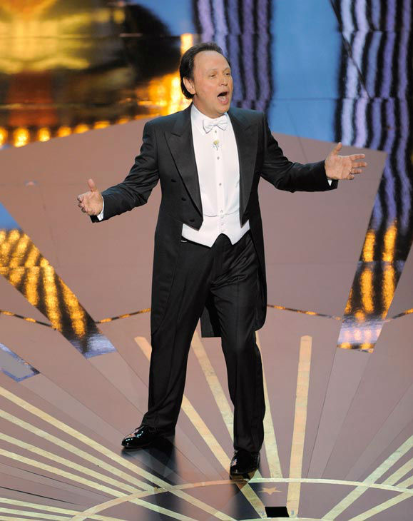 Host Billy Crystal opened the 84th Academy Awards with a movie montage, where he appeared in scenes from the nominated films and said to the audience, &#39;Nothing can distract you from the financial problems of the world like millionaires giving each other gold statues.&#39; <span class=meta>(AP Photo&#47; Mark J. Terrill)</span>