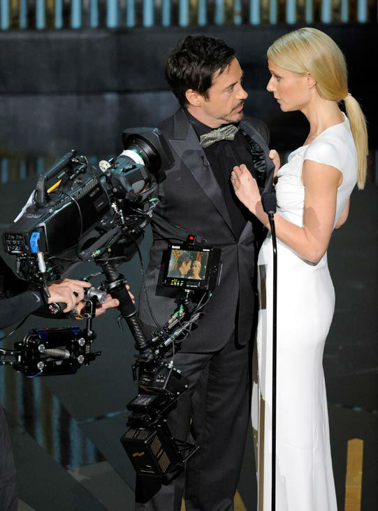 Robert Downey Jr., left, and Gwyneth Paltrow present an award onstage during the 84th Academy Awards on Sunday, Feb. 26, 2012, in the Hollywood section of Los Angeles.