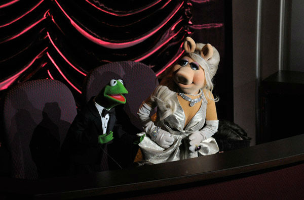 Muppets Kermit the Frog, left, and Miss Piggy...