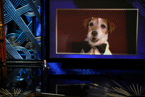 Billy Crystal talks about Uggie, seen  onscreen,...
