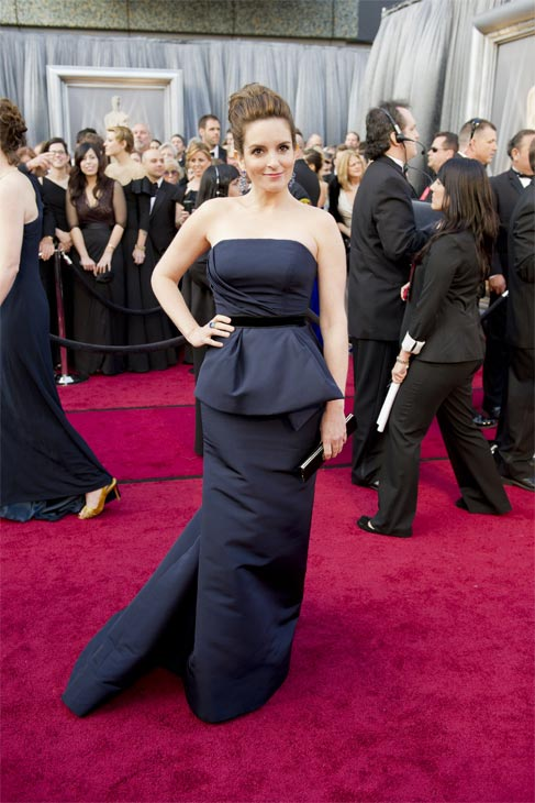 Tina Fey arrives at the 2012 Academy Awards on Feb. 26, 2012. She is wearing a black, strapless Carolina Herrera gown.