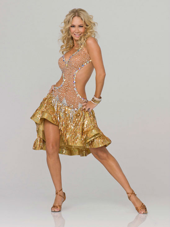 Kym Johnson appears in an official cast photo...