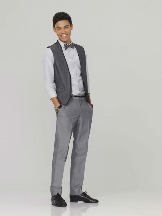 Roshon Fegan appears in an official cast photo...