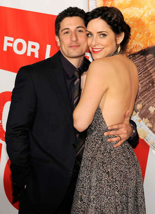 Jason Biggs, left, a cast member in 'American Reunion,' poses with his wife Jenny Mollen at the premiere of the film in Los Angeles, Monday, March 19, 2012. The film is released in theaters on April 6.