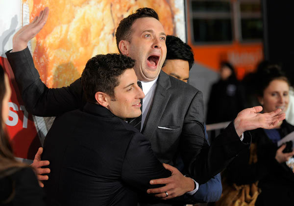 Jason Biggs, left, and Eddie Kaye Thomas, cast members in 'American Reunion,' embrace at the premiere of the film in Los Angeles, Monday, March 19, 2012.