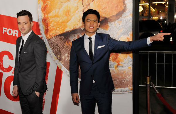 Eddie Kaye Thomas, left, and John Cho, cast members in 'American Reunion,' pose at the premiere of the film in Los Angeles, Monday, March 19, 2012. The film is released in theaters on April 6.