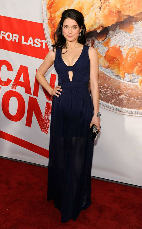 Ali Cobrin, a cast member in 'American Reunion,' poses at the premiere of the film in Los Angeles, Monday, March 19, 2012. The film is released in theaters on April 6.