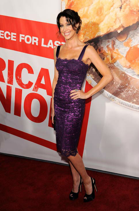 Shannon Elizabeth, a cast member in 'American Reunion,' poses at the premiere of the film in Los Angeles, Monday, March 19, 2012. The film is released in theaters on April 6.
