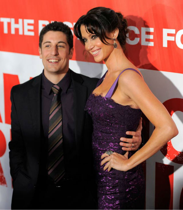 Jason Biggs, left, and Shannon Elizabeth, cast members in 'American Reunion,' pose at the premiere of the film in Los Angeles, Monday, March 19, 2012. The film is released in theaters on April 6.