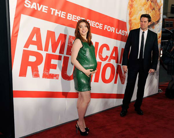 Alyson Hannigan, a cast member in American Reunion, poses with her husband, actor Alexis Denisof, at the premiere of the film in Los Angeles, Monday, March 19, 2012. The film is released in theaters on April 6.