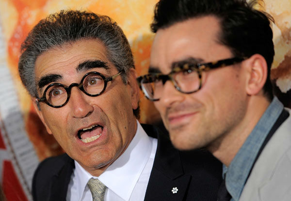 Eugene Levy, left, a cast member in American Reunion, poses with his son Dan Levy at the premiere of the film in Los Angeles, Monday, March 19, 2012. The film will be released in theaters on April 6.