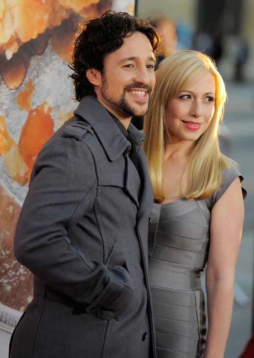 Thomas Ian Nicholas, left, a cast member in 'American Reunion,' and his wife Colette arrive at the premiere of the film in Los Angeles, Monday, March 19, 2012. The film will be released in theaters on April 6.