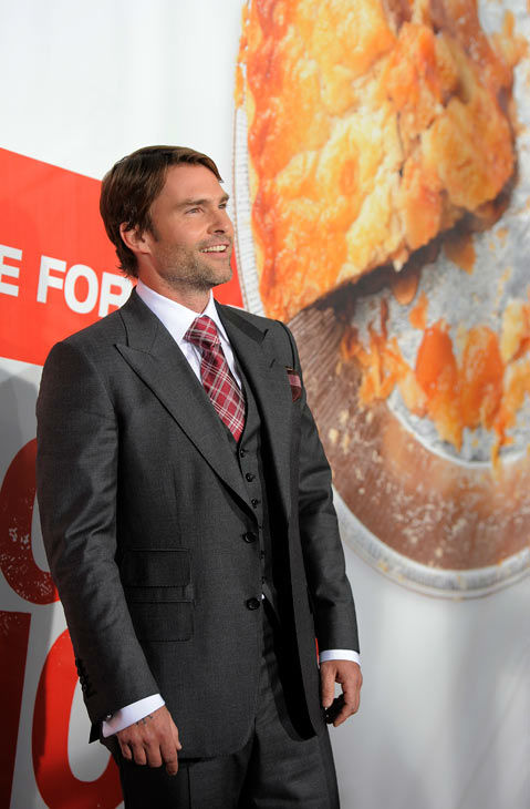 Seann William Scott, a cast member in 'American Reunion,' poses at the premiere of the film in Los Angeles, Monday, March 19, 2012. The film is released in theaters on April 6.