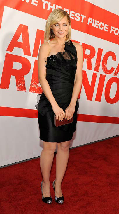 Mena Suvari, a cast member in 'American Reunion,' poses at the premiere of the film in Los Angeles, Monday, March 19, 2012. The film is released in theaters on April 6.
