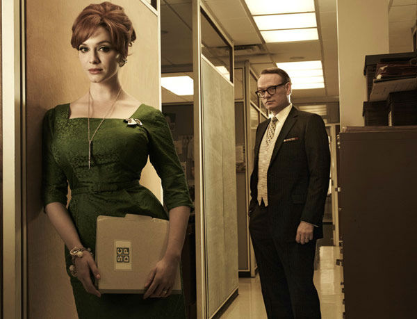 Christina Hendricks (Joan Harris) and Jared Harris (Lane Pryce) appear in a promotional photo for season five of AMC's 'Mad Men,' which premieres on March 25, 2012.
