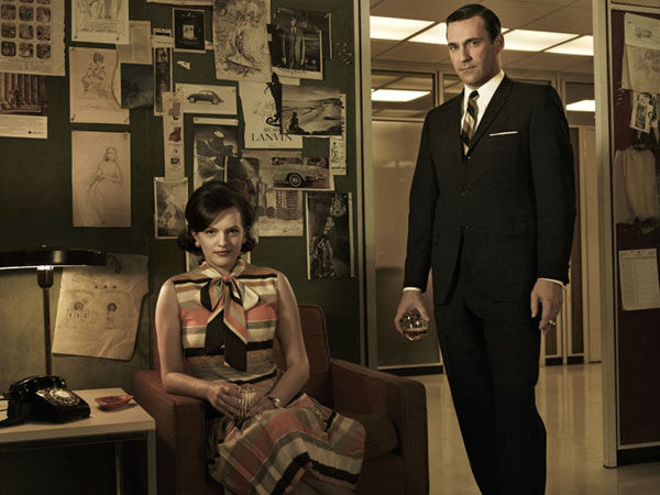 Elisabeth Moss &#40;Peggy Olson&#41; and Jon Hamm &#40;Don Draper&#41; appear in a promotional photo for season five of AMC&#39;s &#39;Mad Men,&#39; which premieres on March 25, 2012. <span class=meta>(Frank Ockenfels 3 &#47; AMC)</span>