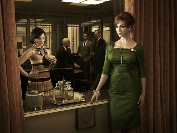 Elisabeth Moss (Peggy Olson), John Slattery (Roger Sterling), Vincent Kartheiser (Pete Campbell), Jon Hamm (Don Draper) and Christina Hendricks (Joan Harris) appear in a promotional photo for season five of AMC's 'Mad Men,' which premieres on March 25, 20