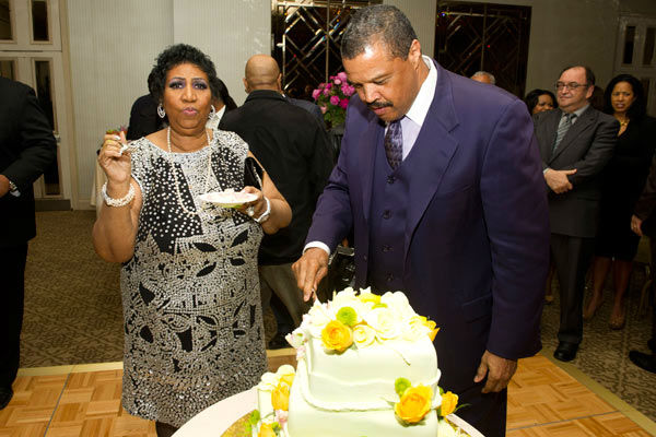 Aretha Franklin and boyfriend William Wilkerson attend her seventieth birthday party in New York, Saturday, March 24, 2012.  <span class=meta>(AP Photo&#47; Charles Sykes)</span>