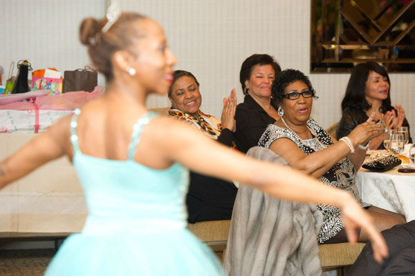 Aretha Franklin watches a dancer perform at her...