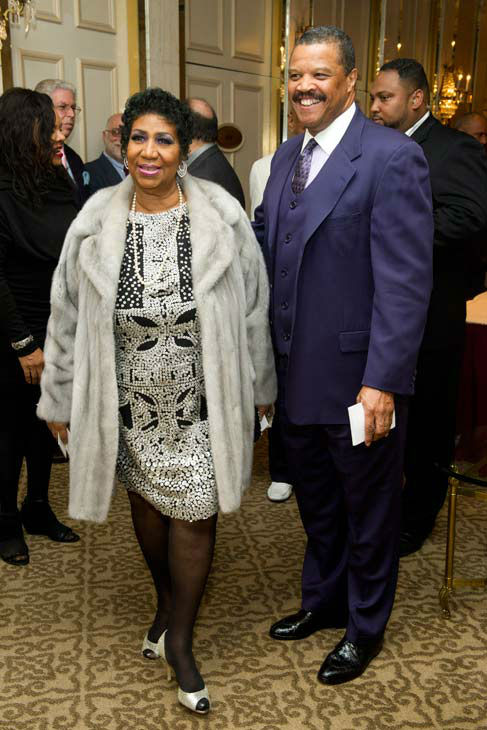 Aretha Franklin and boyfriend William Wilkerson arrive to her seventieth birthday party in New York, Saturday, March 24, 2012.  <span class=meta>(AP Photo&#47; Charles Sykes)</span>