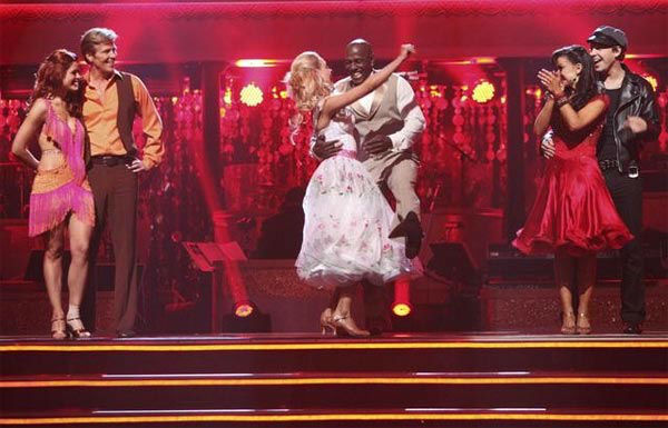 Football player Donald Driver and his partner Peta Murgatroyd react to being safe from elimination on &#39;Dancing With The Stars: The Result Show&#39; on Tuesday, March 27, 2012. The pair received 24 out of 30 points from the judges for their quickstep on the March 26 episode of &#39;Dancing With The Stars.&#39; <span class=meta>(ABC Photo&#47; Adam Taylor)</span>