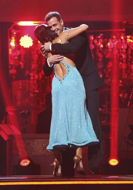 Telenovela star William Levy and his partner Cheryl Burke react to being safe from elimination on 'Dancing With The Stars: The Result Show' on Tuesday, March 27, 2012. The pair received 25 out of 30 points from the judges for their quickst