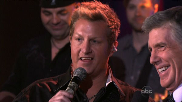 "<div class=""meta image-caption""><div class=""origin-logo origin-image ""><span></span></div><span class=""caption-text"">Rascal Flatts also appeared on the show performing the network TV debut of ""Changed,"" on 'Dancing With The Stars: The Results Show' on Tuesday, April 3, 2012. Their performance was accompanied by pro dancer Tony Dovolani and Troupe member Sharna Burgess. (ABC Photo)</span></div>"