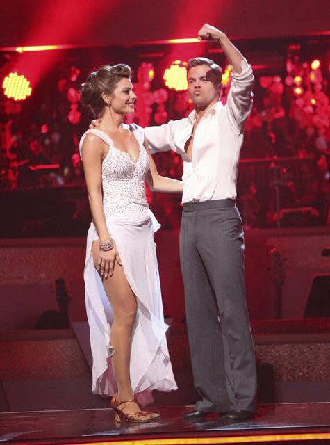 "<div class=""meta ""><span class=""caption-text "">TV personality Maria Menounos and her partner Derek Hough await possible elimination on 'Dancing With The Stars: The Result Show' on Tuesday, April 3, 2012. The pair received 27 out of 30 points from the judges for their Rumba on week three of 'Dancing With The Stars,' which aired on April 2, 2012. (ABC Photo)</span></div>"