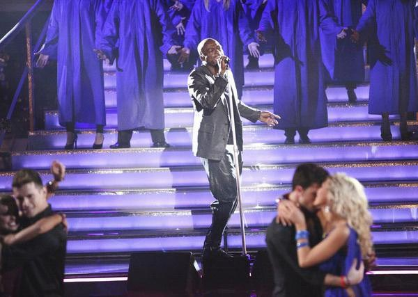 "<div class=""meta image-caption""><div class=""origin-logo origin-image ""><span></span></div><span class=""caption-text"">Seal returned to the ballroom to perform 'Lean On Me' from his latest album 'Soul 2' on 'Dancing With The Stars: The Results Show' on Tuesday, April 3, 2012. His performance was accompanied by four members of the Troupe. (ABC Photo)</span></div>"
