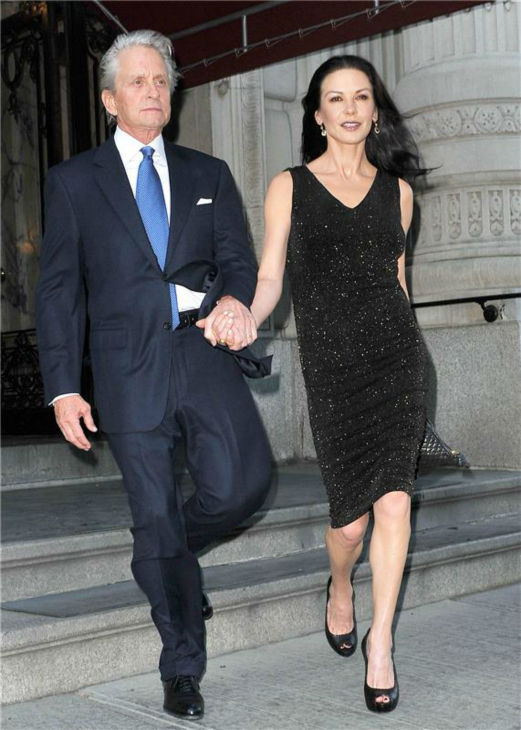 Michael Douglas and Catherine Zeta-Jones leave their apartment in New York on April 16, 2012. <span class=meta>(Humberto Carreno &#47; Startraksphoto.com)</span>
