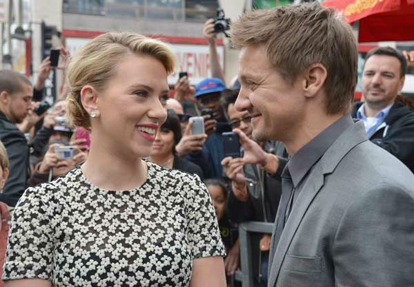 Actor Jeremy Renner poses with actress Scarlett Johansson as she is honored on the Hollywood Walk of Fame on May 2, 2012 in Hollywood, California.  <span class=meta>(Alberto E. Rodriguez&#47;WireImage)</span>