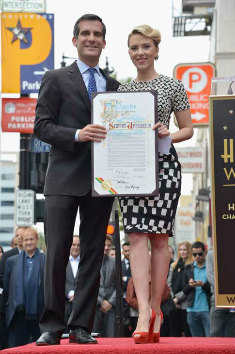 L.A. City Council President Eric Garcetti (L) poses with actress Scarlett Johansson as she is honored on the Hollywood Walk of Fame on May 2, 2012 in Hollywood, California.