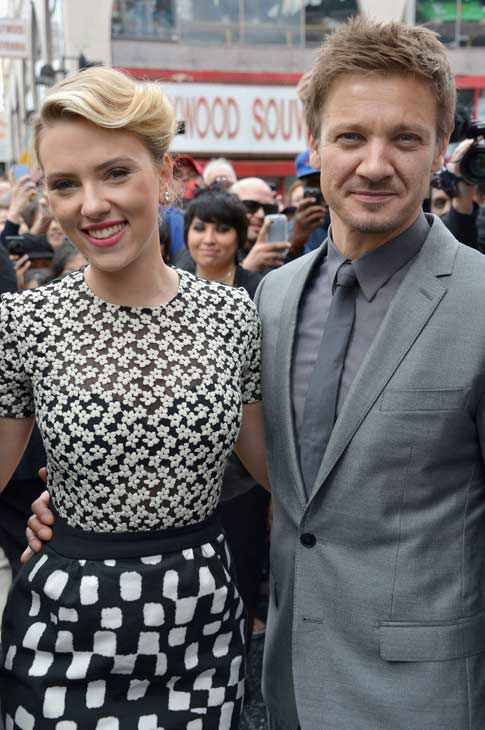 Actor Jeremy Renner poses with actress Scarlett Johansson as she is honored on the Hollywood Walk of Fame on May 2, 2012 in Hollywood, California.
