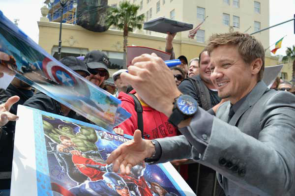 "<div class=""meta ""><span class=""caption-text "">Actor Jeremy Rennersigns autographs while Scarlett Johansson is honored on the Hollywood Walk of Fame on May 2, 2012 in Hollywood, California. (Alberto E. Rodriguez/WireImage)</span></div>"