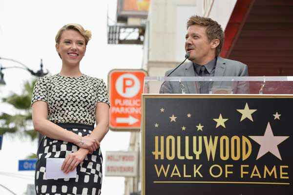 Actor Jeremy Renner (R) speaks while actress Scarlett Johansson is honored on the Hollywood Walk of Fame on May 2, 2012 in Hollywood, California.
