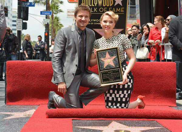 Actor Jeremy Renner &#40;L&#41; poses with actress Scarlett Johansson as she is honored on the Hollywood Walk of Fame on May 2, 2012 in Hollywood, California. <span class=meta>(Alberto E. Rodriguez&#47;WireImage)</span>