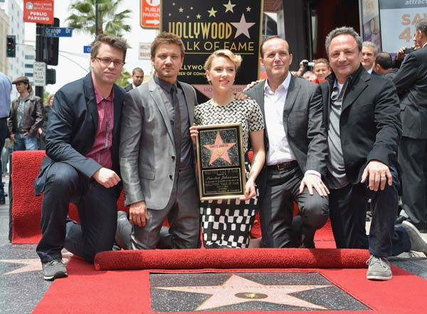 &#40;L-R&#41; Executive Producer Jeremy Latcham, actors Jeremy Renner and Clark Gregg pose with actress Scarlett Johansson as she is honored on the Hollywood Walk of Fame on May 2, 2012 in Hollywood, California.   <span class=meta>(Alberto E. Rodriguez&#47;WireImage)</span>