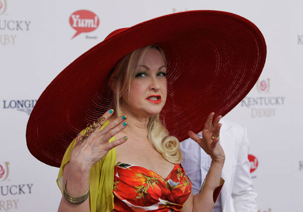 Singer Cyndi Lauper arrives for the 138th Kentucky Derby horse race at Churchill Downs Saturday, May 5, 2012, in Louisville, Ky.  <span class=meta>(AP Photo&#47; Darron Cummings)</span>